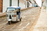 Walk around town or hop on one of the few local motor taxis.